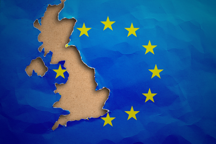 Image of UK with EU flag in background