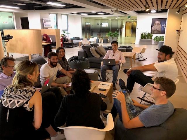 people talking in group at incubator in dubai
